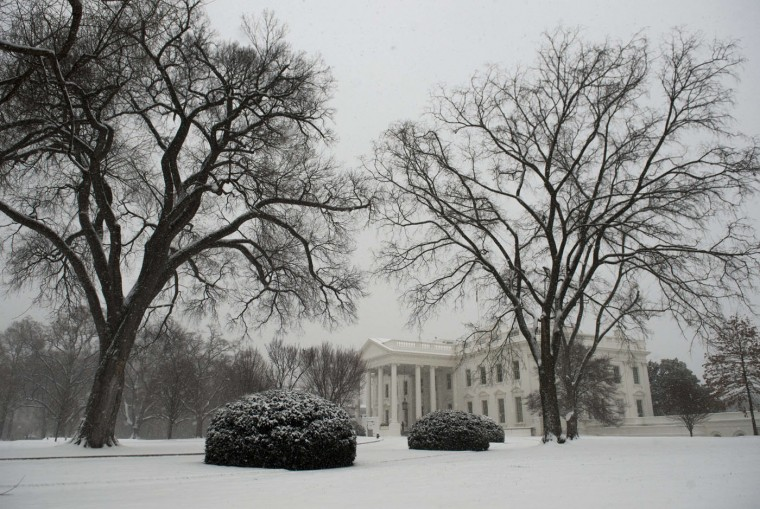 A man walks past the White House during a snow storm January 6, 2015 in Vienna, Virginia. The first significant snowfall of the year wrecked havoc on the morning rush hour in the Washington, DC area. (Saul Loeb/AFP/Getty Images)