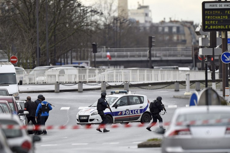 Police forces gather together at Porte de Vincennes, east of Paris, after at least one person was injured when a gunman opened fire at a kosher grocery store on January 9, 2015 and took at least five people hostage, sources told AFP. The attacker was suspected of being the same gunman who killed a policewoman in a shooting in Montrouge in southern Paris on January 8. (Martin Bureau/AFP/Getty Images)