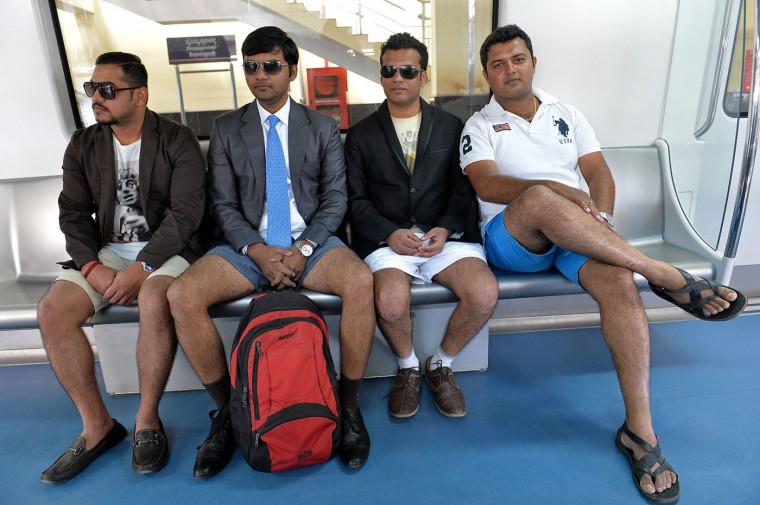 Indian commuters, stripped to their underpants, participate in a No Pants Subway Ride on the metro in Bangalore on January 11, 2015. The No Pants Subway Ride is an annual event staged across major cities of the World every January. The mission started as a small prank with seven guys and has grown into an international celebration of silliness, with dozens of cities around the world participating each year. The idea behind No Pants is simple - random passengers board a subway car at separate stops in the middle of winter without pants. (Manjunath Kiran/AFP/Getty Images)