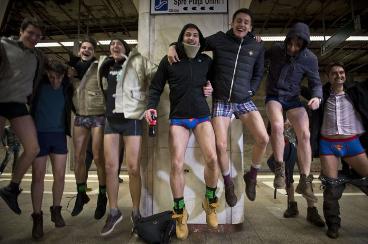 "Young men, stripped to their underpants, jump in the air while waiting for the subway as they take part in Romania's first edition of the ""No pants subway ride day"" organized in Bucharest January 11, 2015. The No Pants Subway Ride is an annual event staged across major cities of the World every January. The mission started as a small prank with seven guys and has grown into an international celebration of silliness, with dozens of cities around the world participating each year. (Daniel Mihailescu/AFP/Getty Images)"