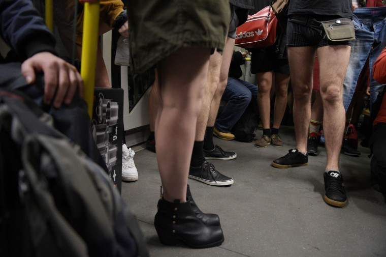 "People stripped to their underpants ride the subway as they take part in the ""No pants subway ride day"" on January 11, 2015 in Berlin. The No Pants Subway Ride is an annual event staged across major cities of the World every January. The mission started as a small prank with seven guys and has grown into an international celebration of silliness, with dozens of cities around the world participating each year. (Rainer Jensen/AFP/Getty Images)"