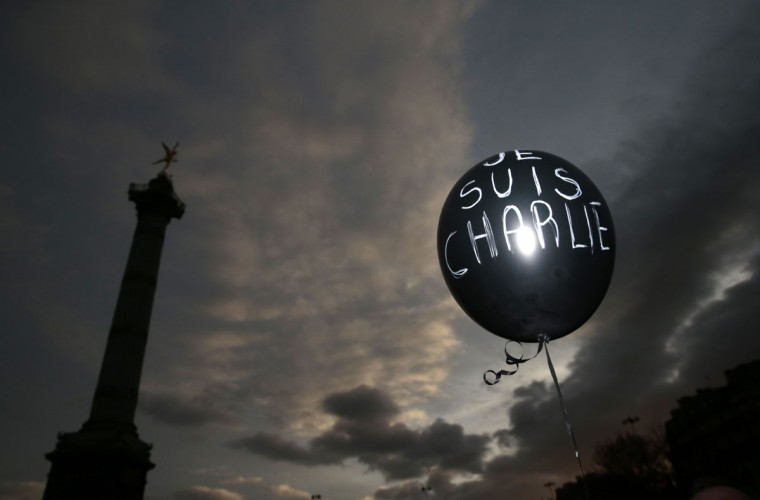"A balloon reading ""Je suis Charlie"" (I am Charlie) is held at Place de la Bastille during the Unity rally ""Marche Republicaine"" on January 11, 2015 in Paris in tribute to the 17 victims of a three-day killing spree by homegrown Islamists. The killings began on January 7 with an assault on the Charlie Hebdo satirical magazine in Paris that saw two brothers massacre 12 people including some of the country's best-known cartoonists, the killing of a policewoman and the storming of a Jewish supermarket on the eastern fringes of the capital which killed 4 local residents. (Joel Saget/AFP/Getty Images)"