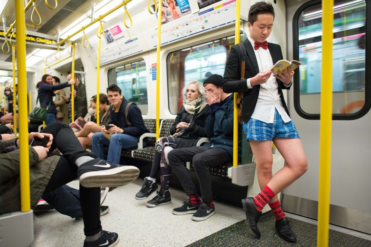"People take part in the annual ""No Trousers On The Tube Day"" event in central London on January 11, 2015. Originally started in the US, the international event, also known as the ""No Pants Subway Ride"" was created by improvisation group ""Improv Everywhere"" and sees people taking train journies while wearing no trousers, yet acting as normally as possible. (Leon Neal/AFP/Getty Images)"