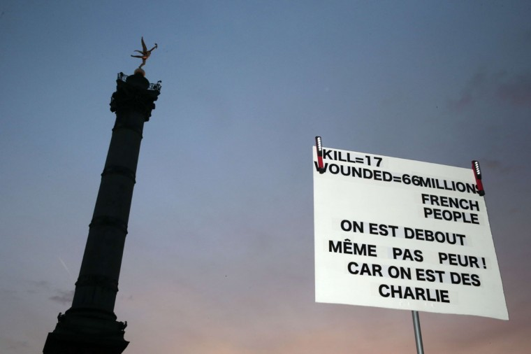 "A placard reading ""17 killed, 66 million people wounded, we are standing, we are not scared because we are Charlie"" is held at Place de la Bastille during the Unity rally ""Marche Republicaine"" on January 11, 2015 in Paris in tribute to the 17 victims of a three-day killing spree by homegrown Islamists. The killings began on January 7 with an assault on the Charlie Hebdo satirical magazine in Paris that saw two brothers massacre 12 people including some of the country's best-known cartoonists, the killing of a policewoman and the storming of a Jewish supermarket on the eastern fringes of the capital which killed 4 local residents. (Joel Saget/AFP/Getty Images)"