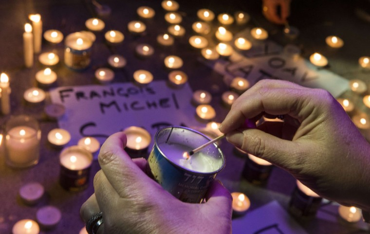 A French-Israeli dual national lights a candle, around the names of French Jews killed in an attack on a supermarket in Paris, during a remembrance ceremony in the coastal city of Netanya on January 11, 2015, to protest against the attack on the French satirical magazine Charlie Hebdo's office that left 12 dead and an attack on a kosher supermarket in Paris. More than a million people and dozens of world leaders were expected to march through Paris in a historic display of global defiance against extremism after Islamist attacks that left 17 dead. For many in Israel, the deadly attack on a kosher supermarket in Paris was further evidence that France is becoming hostile territory for Jews and authorities are unable to protect them. (Jack Guez/AFP/Getty Images)