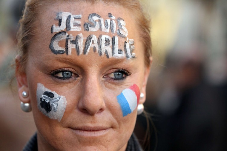 "A woman takes part in the Unity rally ""Marche Republicaine"" that gathered 10.000 persons on January 11, 2015 in Ajaccio, in tribute of the 17 victims of the three-day killing spree by homegrown Islamists in Paris. The killings began on January 7 with an assault on the Charlie Hebdo satirical magazine in Paris that saw two brothers massacre 12 people including some of the country's best-known cartoonists and the storming of a jewish supermarket on the eastern fringes of the capital which killed 4 local residents. (Pascal Pochard-Casabianca/AFP/Getty Images)"
