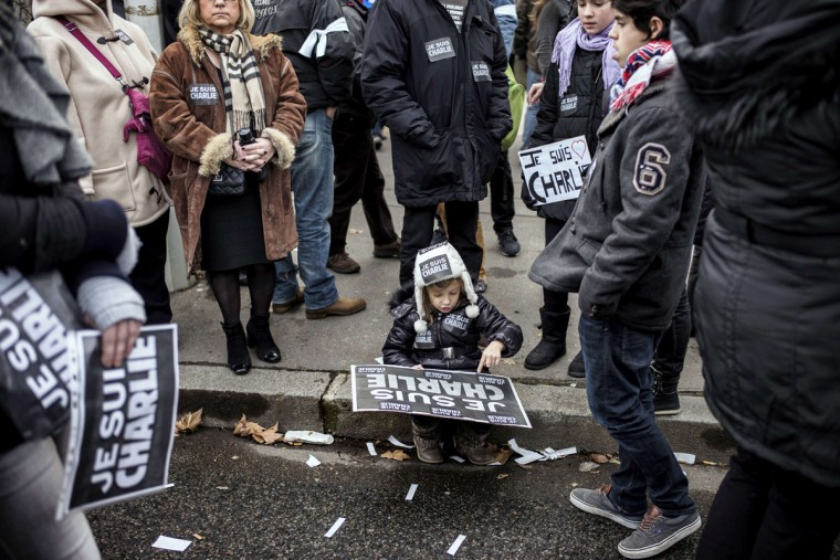 "A child holds a placard reading ""Je suis Charlie"" (I am Charlie) during a Unity rally Marche Republicaine on January 11, 2015 in Lyon in tribute to the 17 victims of the three-day killing spree. The killings began on January 7 with an assault on the Charlie Hebdo satirical magazine in Paris that saw two brothers massacre 12 people including some of the country's best-known cartoonists and the storming of a Jewish supermarket on the eastern fringes of the capital which killed 4 local residents. (Jeff Pachoud/AFP/Getty Images)"