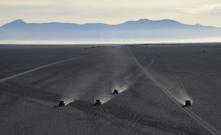 Drivers compete during 2015 Dakar Rally stage 8 between Uyuni and Iquique, Bolivia, on January 11, 2015. The Uyuni salt flat is the largest in the world, located in Bolivia near the crest of the Andes, some 3,650 meters above sea level. (Frank Fife/AFP/Getty Images)