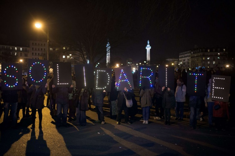 "People hold letters to form the word ""solidarity"" during the Unity rally ""Marche Republicaine"" on January 11, 2015 in Paris in tribute to the 17 victims of a three-day killing spree by homegrown Islamists. The killings began on January 7 with an assault on the Charlie Hebdo satirical magazine in Paris that saw two brothers massacre 12 people including some of the country's best-known cartoonists, the killing of a policewoman and the storming of a Jewish supermarket on the eastern fringes of the capital which killed 4 local residents. (Martin Bureau/AFP/Getty Images)"