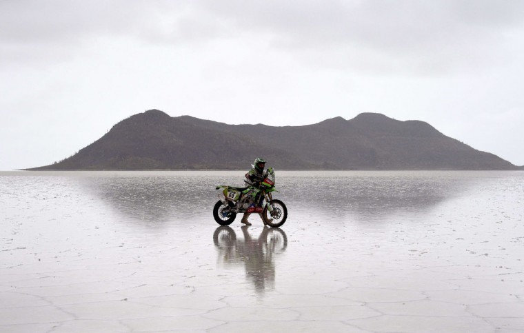 Kawasaki's Chilean Patricio Cabrera pushes his bike during 2015 Dakar Rally stage 8 between Uyuni, Bolivia and Iquique, Chile, on January 12, 2015. The Uyuni salt flat is the largest in the world, located in Bolivia near the crest of the Andes, some 3,650 meters above sea level. (Frank Fife/AFP/Getty Images)