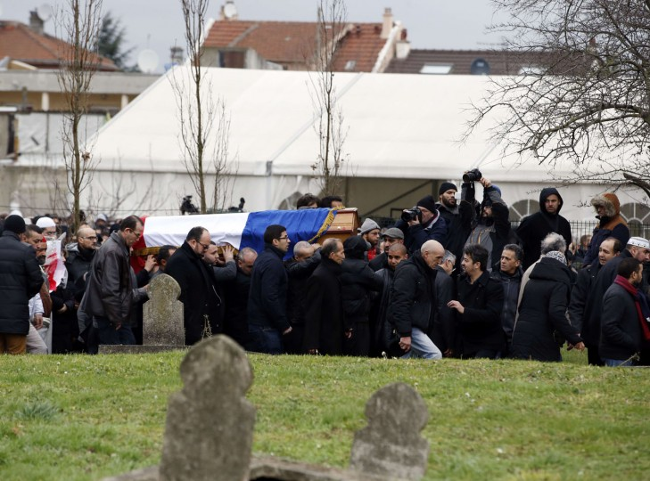 People carry the coffin of French police officer Ahmed Merabet during a funeral ceremony on January 13, 2015 in Bobigny, near Paris, after he was killed on January 7 by Islamist gunmen during the attack of French satirical newspaper Charlie Hebdo. Seventeen people, including journalists, policemen, a black police woman, Muslims and Jews lost their lives in the attacks in Paris. France has Europe's largest Muslim and Jewish populations and the attacks prompted a historic outpouring of unity and saw nearly four million people rally across the country on January 11, 2015. Kenzo Tribouillard/AFP/Getty Images