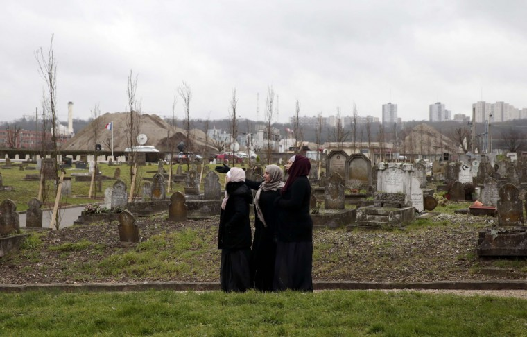 Women looks on during a funeral ceremony of French police officer Ahmed Merabet, on January 13, 2015 in Bobigny, near Paris, after he was killed on January 7 by Islamist gunmen during the attack of French satirical newspaper Charlie Hebdo. Seventeen people, including journalists, policemen, a black police woman, Muslims and Jews lost their lives in the attacks in Paris. France has Europe's largest Muslim and Jewish populations and the attacks prompted a historic outpouring of unity and saw nearly four million people rally across the country on January 11, 2015. Joel Saget/AFP/Getty Images