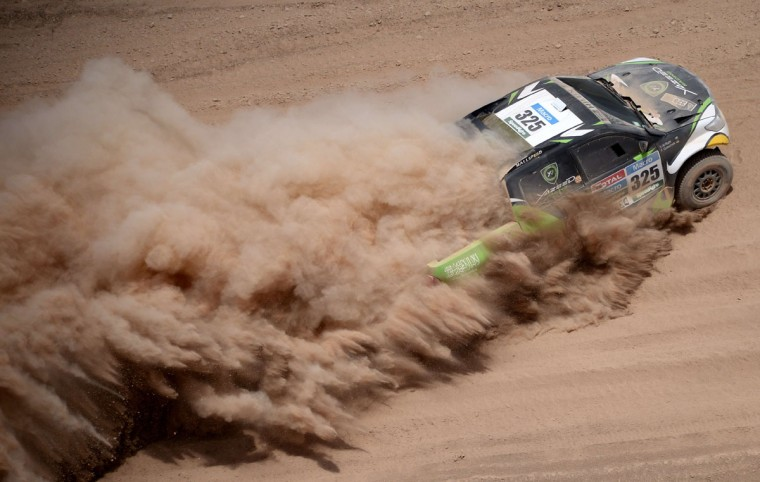 Toyota's driver Yazeed Alrajhi, of Saudi Arabia, and co-driver Timo Gottschalk of Germany, compete during the Stage 9 of the Dakar 2015 between Iquique and Calama, Chile, on January 13, 2015. (Frank Fife/AFP/Getty Images)