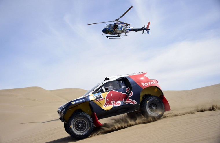 Peugeot driver Stephane Peterhansel of France and co-driver Jean Paul Cottret compete during the Stage 9 of the Dakar 2015 between Iquique and Calama, Chile, on January 13, 2015. (Frank Fife/AFP/Getty Images)
