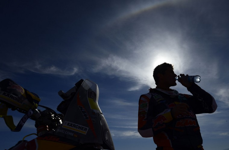 KTM's Spanish biker Marc Coma drinks some water after a refueling during the Stage 9 of the Dakar 2015 between Iquique and Calama, Chile, on January 13, 2015. (Frank Fife/AFP/Getty Images)