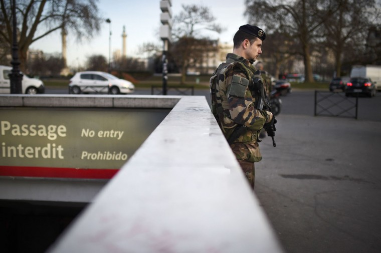 "A French soldier patrols on January 14, 2015 on Place de la Nation in Paris, as part of the country's Vigipirate security measures. France announced an unprecedented deployment of thousands of troops and police to bolster security at ""sensitive"" sites including Jewish schools on January 12, a day after marches gathering nearly four million people countrywide. (Martin Bureau/AFP/Getty Images)"
