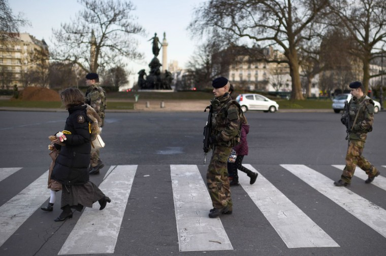 "Soldiers patrol on January 14, 2015 on Place de la Nation in Paris, as part of the country's Vigipirate security measures. France announced an unprecedented deployment of thousands of troops and police to bolster security at ""sensitive"" sites including Jewish schools on January 12, a day after marches gathering nearly four million people countrywide. (Martin Bureau/AFP/Getty Images)"