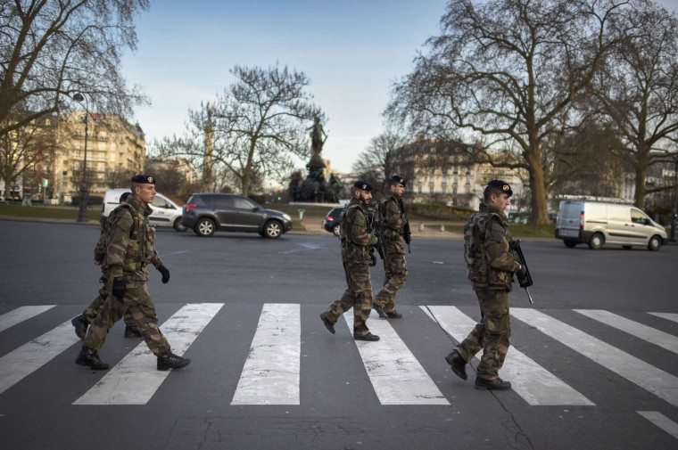 "Soldiers patrol on January 14, 2015 on Place de la Nation in Paris, as part of the country's Vigipirate security alert system. France announced an unprecedented deployment of thousands of troops and police to bolster security at ""sensitive"" sites including Jewish schools on January 12, a day after marches gathering nearly four million people countrywide. (Martin Bureau/AFP/Getty Images)"