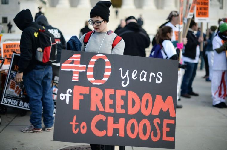 A pro-choice activists holds a placard in front of the US Supreme Court in Washington, DC, January 22, 2015, as she and others await the pro-choice activists with the March For Life. (JIM WATSON/AFP/Getty Images)