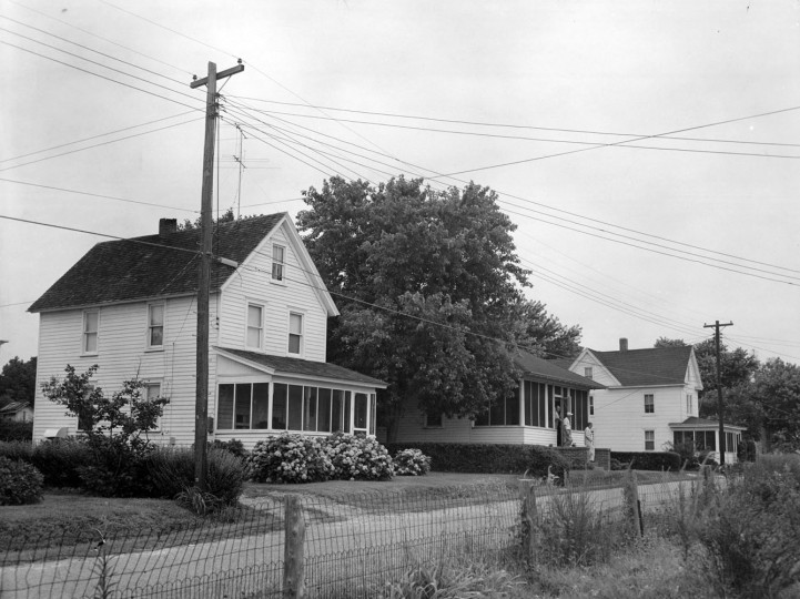 These houses, once on Hog Island, were ferried to the mainland when threatened by the ocean. (A. Aubrey Bodine, Baltimore Sun)