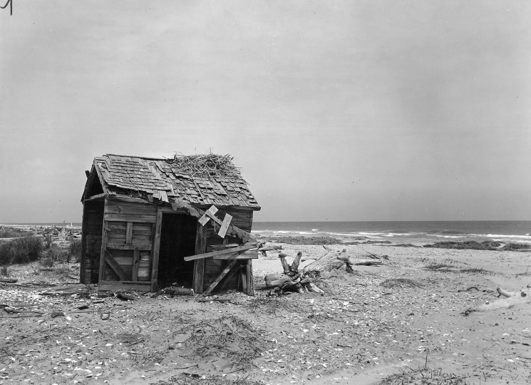 Sagging shanties recall the time when a community of 250 people lived on Hog Island. The shacks still standing on the beach bear the ocean's calling card -- driftwood left on the roof. (A. Aubrey Bodine, Baltimore Sun)