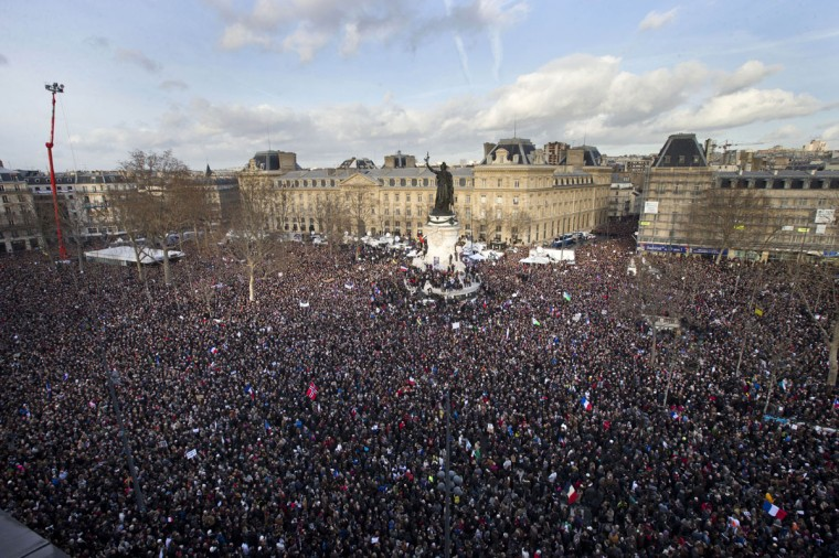 Thousands of people gather at Republique square in Paris, France, Sunday, Jan. 11, 2015. Thousands of people began filling Franceís iconic Republique plaza, and world leaders converged on Paris in a rally of defiance and sorrow on Sunday to honor the 17 victims of three days of bloodshed that left France on alert for more violence. (AP Photo/Peter Dejong)