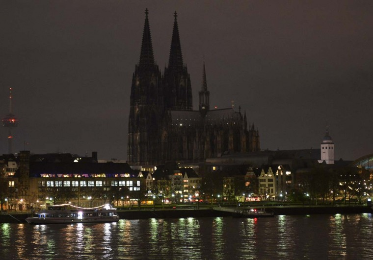 The illumination of the world famous Cologne cathedral goes out during a rally called 'Patriotic Europeans against the Islamization of the West' (PEGIDA) in Cologne, Germany, Monday evening, Jan. 5, 2015. The church wants to protest against intolerance of the anti Islamic movement, that came up in many German cities. (AP Photo/Martin Meissner)