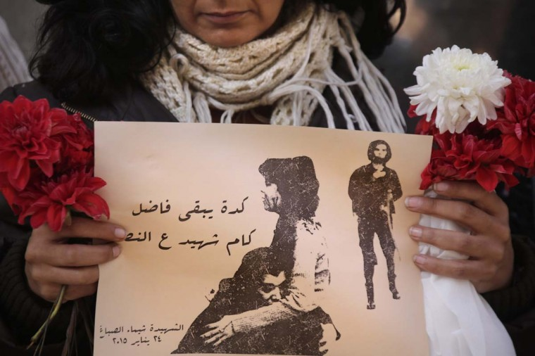 "An Egyptian protester holds a poster of Shaimaa el-Sabagh, an activist who was shot dead at a small peaceful protest last Saturday, and Arabic that reads, "" how many martyrs remaining for victory,"" during a women's protest in Cairo, Egypt, Thursday, Jan. 29, 2015. Dozens of women have rallied in the Egyptian capital, denouncing the killing of a female protester and blaming the police for her death during a peaceful demonstration last week. (AP Photo/Amr Nabil)"