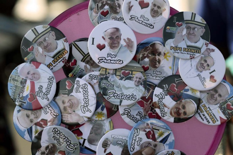 Pope Francis souvenirs are displayed by street vendors in Manila, Philippines, Thursday, Jan. 15, 2015. Pope Francis arrives Thursday from Sri Lanka for a pastoral visit which is expected to draw millions of faithful where about 81-percent of the population is Catholic. (AP Photo/Wally Santana)