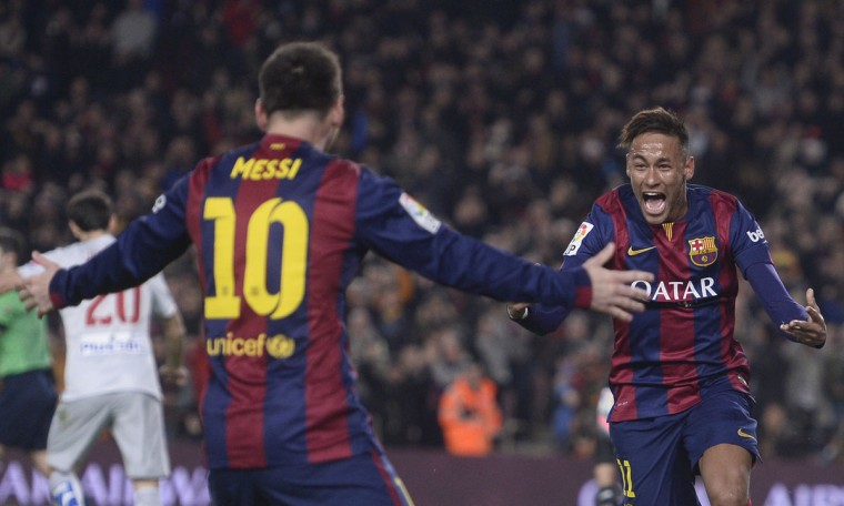 FC Barcelona's Neymar, from Brazil, right, celebrates with Lionel Messi after scoring against Atletico Madrid during a Spanish La Liga soccer match at the Camp Nou stadium in Barcelona, Spain, Sunday, Jan. 11, 2015. (AP Photo/Manu Fernandez)