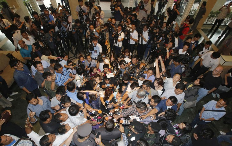 Singtong Buechoom, a legal team member of the Pheu Thai Party, is surrounded by journalists while speaking about former Thai Prime Minister Yingluck Shinawatra in Bangkok, Thailand, Friday, Jan. 23, 2015. A military-appointed legislature voted to impeach Yingluck on Friday, a move that could further polarize a divided nation that's been beset by political upheaval for a decade. (AP Photo/Sakchai Lalit)