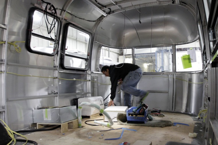 Joe Roberts, of Jackson Center, works on an Airstream travel trailer at the Airstream factory Wednesday, Oct. 22, 2014, in Jackson Center, Ohio. (AP Photo/Jay LaPrete)