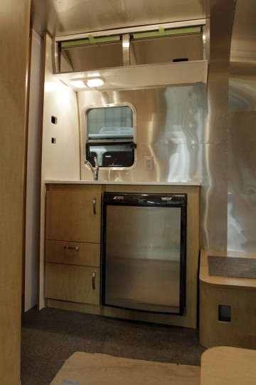 The kitchen area of an Airstream travel trailer at the Airstream factory Wednesday, Oct. 22, 2014, in Jackson Center, Ohio. (AP Photo/Jay LaPrete)
