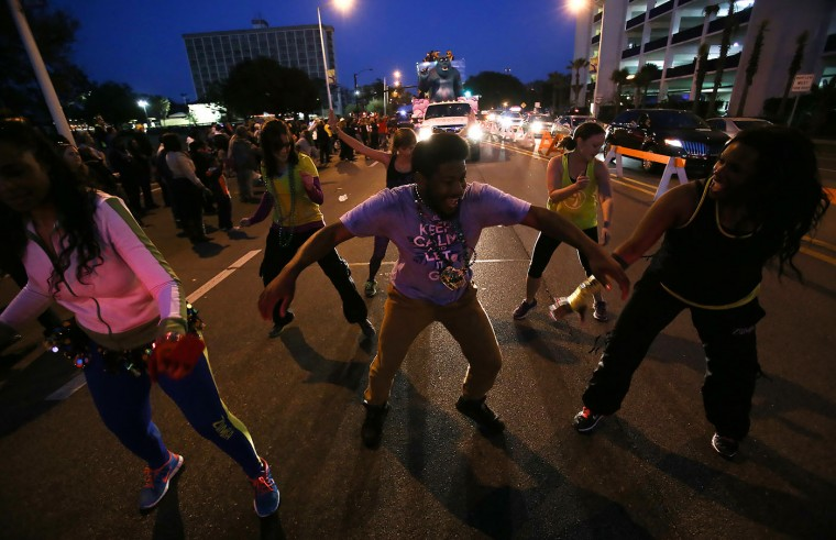 Zumba instructors dance during the Krewe of Neptune parade in Biloxi, Miss., Saturday, Feb. 14, 2015. Thousands lined the streets of Biloxi as the parade rolled for the first time since Hurricane Katrina. (AP Photo/Sun Herald, Amanda McCoy)