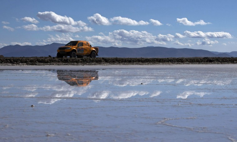 Toyota driver Maik Willems and co-pilot Robert Van Pelt, both from the Netherlands, race across the Uyuni salt flats during the eighth stage of the Dakar Rally 2015 between Uyuni, Bolivia, and Iquique, Chile, Sunday, Jan. 11, 2015. The race will finish on Jan. 17, passing through Bolivia and Chile before returning to Argentina where it started. (AP Photo/Felipe Dana)