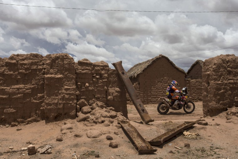 KTM rider Marc Coma, from Spain, races during the seventh stage of Dakar Rally 2015 between Iquique, Chile, and Uyuni, Bolivia, Sunday, Jan. 11, 2015. The race will finish on Jan. 17, passing through Bolivia and Chile before returning to Argentina where it started. (AP Photo/Felipe Dana)