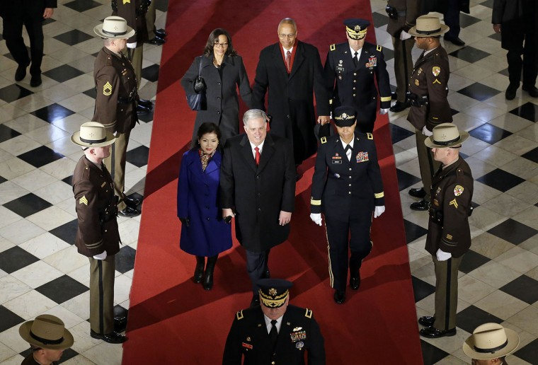 Maryland Gov.-elect Larry Hogan, center, enters the statehouse alongside his wife Yumi in front of Maryland Lt. Gov.-elect Boyd Rutherford, top center, and his wife Monica, before inaugural ceremonies, Wednesday, Jan. 21, 2015, in Annapolis, Md. (AP Photo/Patrick Semansky)