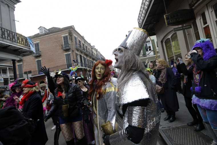 Revelers celebrate Mardi Gras in the French Quarter in New Orleans, Tuesday, Feb. 17, 2015. (AP Photo/Gerald Herbert)