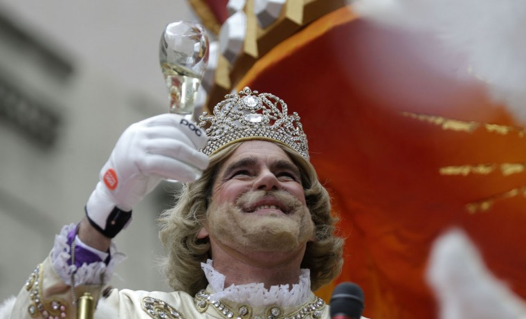 Rex, King of Carnival, Christian T. Brown, toasts the crowd during the Krewe of Rex parade on Mardi Gras in New Orleans, Tuesday, Feb. 17, 2015. Revelers in glitzy costumes filled the streets of New Orleans for the annual fat Tuesday bash, opening a day of partying and parades. (AP Photo/Gerald Herbert)