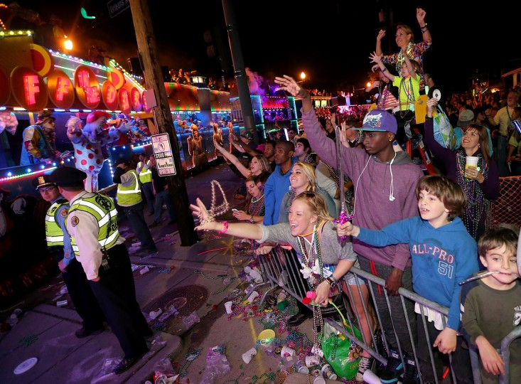 "Crowds scream for beads on Orleans Avenue as the 3,000 men of the Krewe of Endymion roll down their traditional Mid-City route with their Carnival parade ""Fantastic Voyages"" in New Orleans, Saturday, Feb. 14, 2015. (AP Photo/The Times-Picayune, Michael DeMocker)"