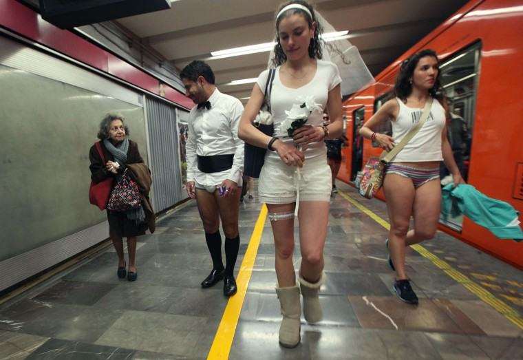 "An elderly woman, left, looks at a man who lacks his pants during the annual ""No Pants Subway Ride"" at a subway station in Mexico City, Sunday, Jan. 11, 2015. The annual No Pants Subway Ride began in 2002 in New York as a stunt that organizers call ìan international celebration of silliness,î and has spread to other cities. (AP Photo/Marco Ugarte)"