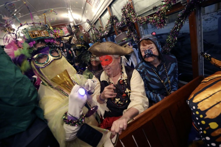 Members of the Phunny Phorty Phellows, participate in their night of revelry aboard a streetcar in New Orleans, Tuesday, Jan. 6, 2015. King's Day is a tradition marking the 12th night after Christmas and the official start of the Mardi season. Carnival is celebrated along the Gulf Coast with parties, balls and parades culminating on Mardi Gras, or Fat Tuesday, a final day of celebration before Lent. It is a major tourist draw in New Orleans. Mardi Gras falls on Feb. 17 this year. (AP Photo/Gerald Herbert)