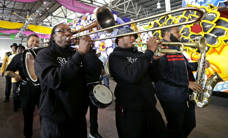 Members of the Stooges Brass Band perform in a second-line procession during King's Day festivities in New Orleans, Tuesday, Jan. 6, 2015. King's Day is a tradition marking the 12th night after Christmas and the official start of the Mardi season. Carnival is celebrated along the Gulf Coast with parties, balls and parades culminating on Mardi Gras, or Fat Tuesday, a final day of celebration before Lent. It is a major tourist draw in New Orleans. Mardi Gras falls on Feb. 17 this year. (AP Photo/Gerald Herbert)
