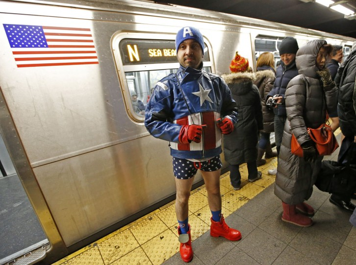 A patriotic commuter waits for a train during the annual No Pants Subway Ride, Sunday, Jan. 11, 2015, in New York. The No Pants Subway Ride began in 2002 in New York as a public prank and has since been celebrated by commuters around the world. (AP Photo/Kathy Willens)