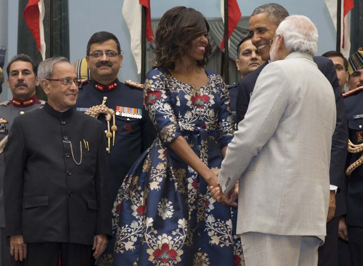 President Barack Obama and first lady Michelle Obama greet Indian Prime Minister Narendra Modi, right, as Indian President Pranab Mukherjee stands left, during a receiving line before State Dinner at the Rashtrapati Bhavan, the presidential palace, in New Delhi, India, Sunday, Jan. 25, 2015. Obama's arrival Sunday morning in the bustling capital of New Delhi marked the first time an American leader has visited India twice during his presidency. Obama is also the first to be invited to attend India's Republic Day festivities, which commence Monday and mark the anniversary of the enactment of the country's democratic constitution. (AP Photo/Carolyn Kaster)
