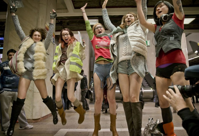 Women jump for a photograph as they take part in the first edition of the No Pants Subway Ride in Bucharest, Romania, Sunday, Jan. 11, 2015. The No Pants Subway Ride began in 2002 in New York as a stunt and has taken place in cities around the world since then. Organizers call it ìan international celebration of sillinessî and are organizing it in dozens of cities on Sunday. (AP Photo/Vadim Ghirda)