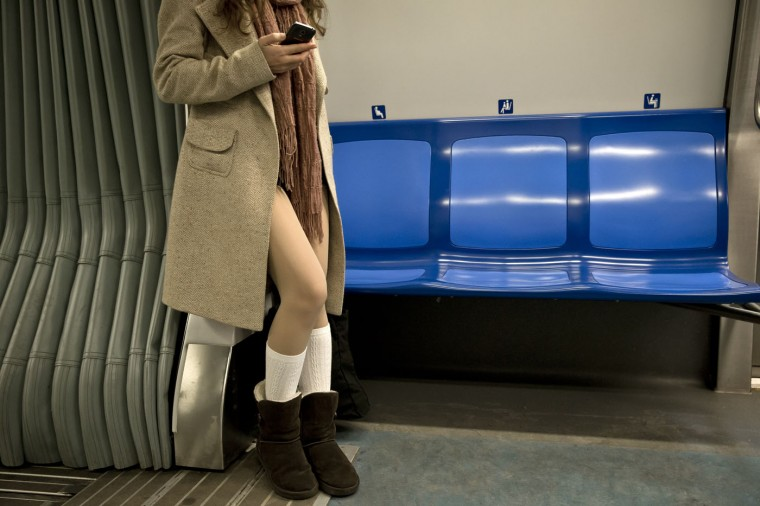 A girl rides on a train as she takes part in the first edition of the No Pants Subway Ride in Bucharest, Romania, Sunday, Jan. 11, 2015. The No Pants Subway Ride began in 2002 in New York as a stunt and has taken place in cities around the world since then. Organizers call it ìan international celebration of sillinessî and are organizing it in dozens of cities on Sunday. (AP Photo/Vadim Ghirda)