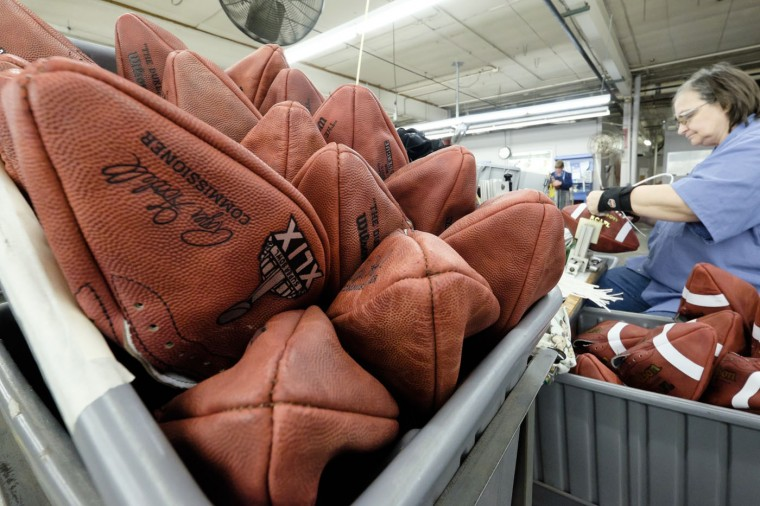 Official game balls for NFL football's Super Bowl XLIX wait to be laced at the Wilson Sporting Goods Co. in Ada, Ohio, Tuesday, Jan. 20, 2015. The New England Patriots face the Seattle Seahawks for the NFL championship on Sunday, Feb. 1, 2015, in Glendale, Ariz. (AP Photo/Rick Osentoski)