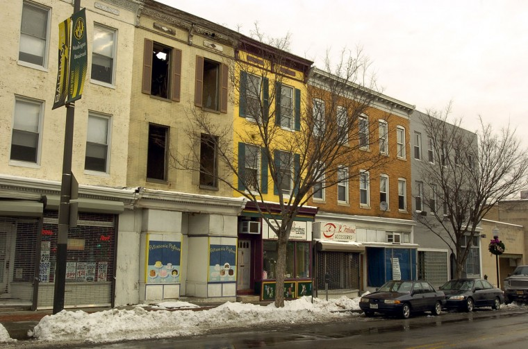 "January 25, 2005: 784 Washington Boulevard, the gutted building second from the left, is one of about 11 vacant properties along Pigtown's ""main street,"" Washington Blvd, to be acquired by the city at fair market value to spur redevelopment. Amy Davis/Baltimore Sun"