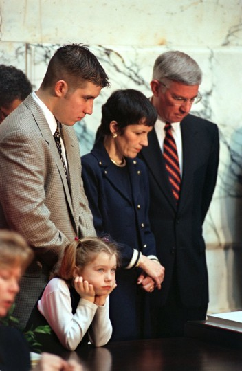 Raymond Glendening, Kerry Townsend, 6 (daughter of Lt. Gov. Kathleen Kennedy Townsend), Frances and Parris Glendening bow their heads during prayer following his swearing in ceremony at the State House in Annapolis on the Governor's Inauguration Wed., Jan. 20, 1999. (Baltimore Sun/Karl Merton Ferron)
